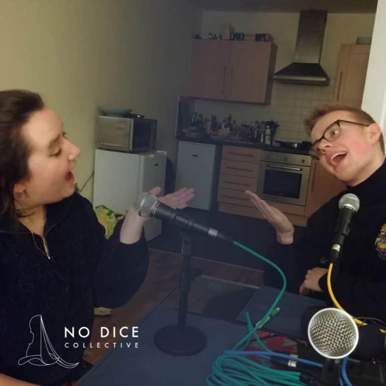 Georgia Affonso and Hugh Morris make a silly pose recording the No Dice podcast
