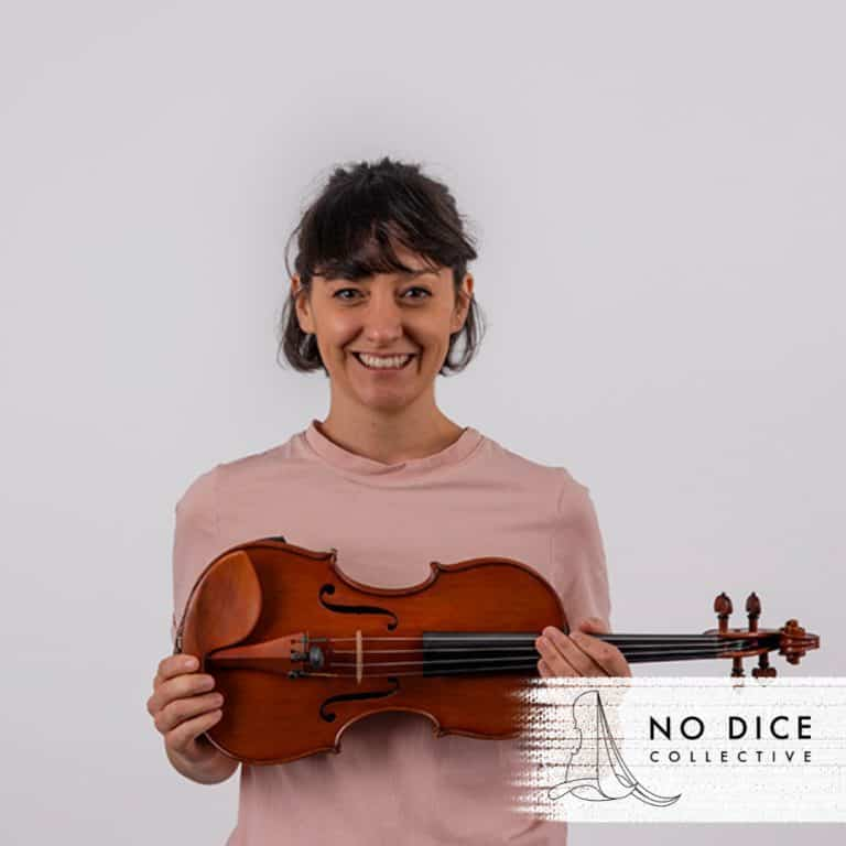 Gemma Bass of Vonnegut Collective holding her violin