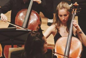 Anna Galloway playing cello for MUMS Orchestra